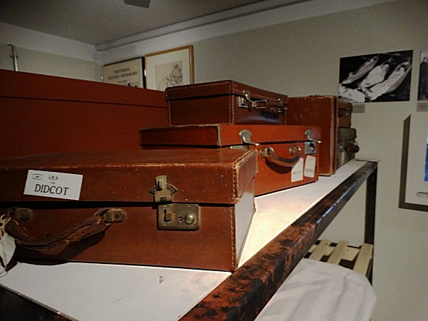 Suit cases in a shelter on top of bunk beds